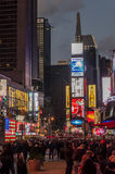 Illuminated facades of Broadway stores and theaters Stock Photo