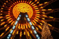 Illuminated ferris wheel and Christmas tree on a Christmas marke Royalty Free Stock Photo