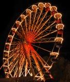 Illuminated ferris wheel at night Royalty Free Stock Images