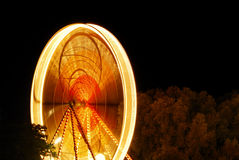 Illuminated ferris wheel at night Stock Images