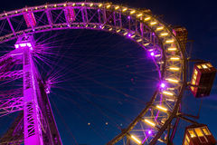 Illuminated ferris wheel at night Stock Image