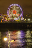 Illuminated ferris wheel at Santa Monica Pier, Los Angeles Stock Photo