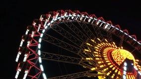 Illuminated ferris wheel stock video