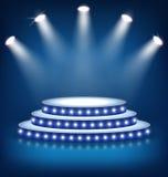 Illuminated Festive Stage Podium with Lamps on Blue Royalty Free Stock Image