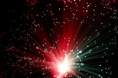 Illuminated Fiber Optic Strands on Black Stock Photo