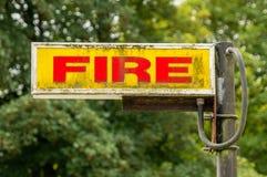 Illuminated Fire sign with patina royalty free stock photos