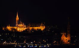Illuminated Fisherman`s Bastion and Calvinist Church Stock Photography