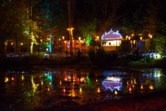 Illuminated Forest and Lake. Arreton, Isle of Wight, United Kingdom - October 20th 2014: Coloured lanterns illuminate the forest and lake in the Electric Woods Stock Images
