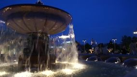 Illuminated fountain closeup at night. Fountain with illumination at night in a city in summer time stock footage