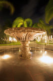 Illuminated fountain at night Stock Photos