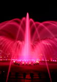 Illuminated Fountain at night. Fountain at night illuminated with pink light Stock Images