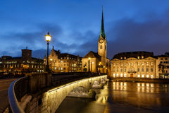 Illuminated Fraumunster Church and River Limmat Royalty Free Stock Photos