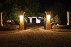 Illuminated garden courtyard at night. Night photo of an illuminated garden courtyard in France taken at night stock photography