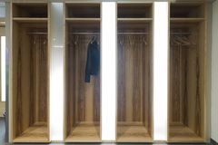 Illuminated garderobe with one single jacket Stock Image