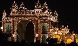 Illuminated gate of Mysore city palace at night stock photos