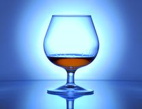 Illuminated glass with cognac Royalty Free Stock Images