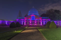Illuminated glass conservatory in Syon Park Royalty Free Stock Image