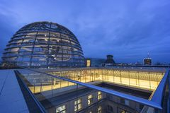 Exterior of the Reichstag dome in Berlin at dusk royalty free stock image