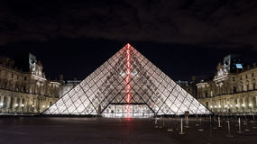 Illuminated glass pyramid at the Louvre, Paris Stock Image