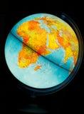 Illuminated Globe. On a black background Stock Images