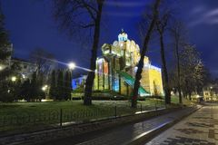 Illuminated Golden Gate and Yaroslav the Wise monument - one of the famous landmark of Kyiv at winter morning. Ukraine Stock Photo