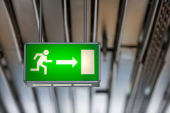 Illuminated green exit sign Stock Photography