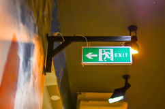 Illuminated green exit sign Royalty Free Stock Images