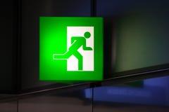 Illuminated green exit sign Stock Photo