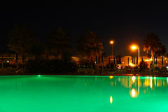 Outdoor swimming pool at night Stock Photo