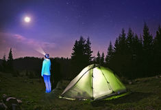 Illuminated  green  tent under stars at night  forest , Carpathi. An ,Ukraine Royalty Free Stock Photo