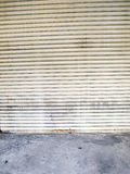 Illuminated grunge metallic roller shutter door Royalty Free Stock Image