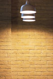 Illuminated grunge yellow brick wall background Stock Photography