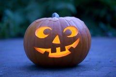 Illuminated Halloween pumkin in the garden Stock Photos