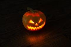 Illuminated halloween pumpkin on black background Stock Photo