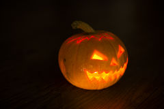 Illuminated halloween pumpkin on black background Stock Photos