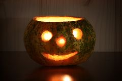 Illuminated halloween pumpkin, photo still life royalty free stock photography