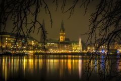 Illuminated Hamburg Christmas Market with town hall royalty free stock photo