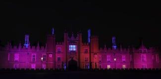 Illuminated Hampton Court Palace by night in Hampton Court, London, United Kingdom. Illuminated Hampton Court Palace by night - Hampton Court, London, United stock images