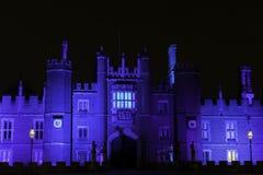 Illuminated Hampton Court Palace by night in Hampton Court, London, United Kingdom. Illuminated Hampton Court Palace by night - Hampton Court, London, United royalty free stock image
