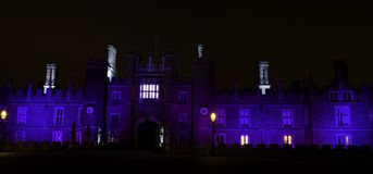 Illuminated Hampton Court Palace by night in Hampton Court, London, United Kingdom. Illuminated Hampton Court Palace by night - Hampton Court, London, United stock image