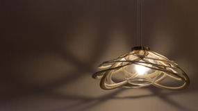 An illuminated hanging lamp. On the wall stock photo