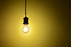 Illuminated hanging led  light bulb over orange background Royalty Free Stock Image