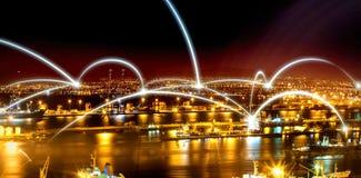 Illuminated harbor against cityscape Stock Photos