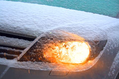 Illuminated headlight. Illuminated headlight at snowy weather Royalty Free Stock Photo