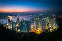 Illuminated high-rise apartment blocks in Yau Tong as seen from Devil's Peak, Kowloon Stock Photos