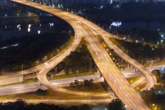 Illuminated highway intersection at night. Royalty Free Stock Photography