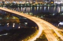 Illuminated highway intersection at night. Stock Image