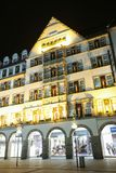 Illuminated Hirmer department sore. MUNICH, GERMANY - DECEMBER 11, 2017 : A view of the decorated illuminated exterior of the Hirmer department store at night in Stock Photos