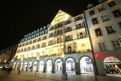 Illuminated Hirmer department sore. MUNICH, GERMANY - DECEMBER 11, 2017 : A view of the decorated illuminated exterior of the Hirmer department store at night in Royalty Free Stock Photography