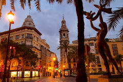 Illuminated historical buildings at the Reina square in Valencia, Spain Stock Photo